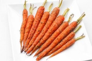Easy Garlic and Herb Roasted Carrots is the perfect side dish to your holiday