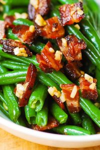 Garlic and Bacon Green Beans sautéed in olive oil and butter in a large skillet on stove top