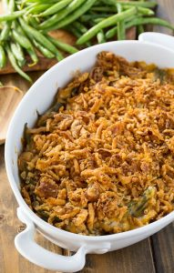 Cheesy Green Bean Casserole that is made from fresh green beans with sautéed mushrooms and a crunchy fried onion topping