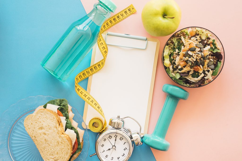 Food with Tape Measure and Alarm Clock to Weight Loss